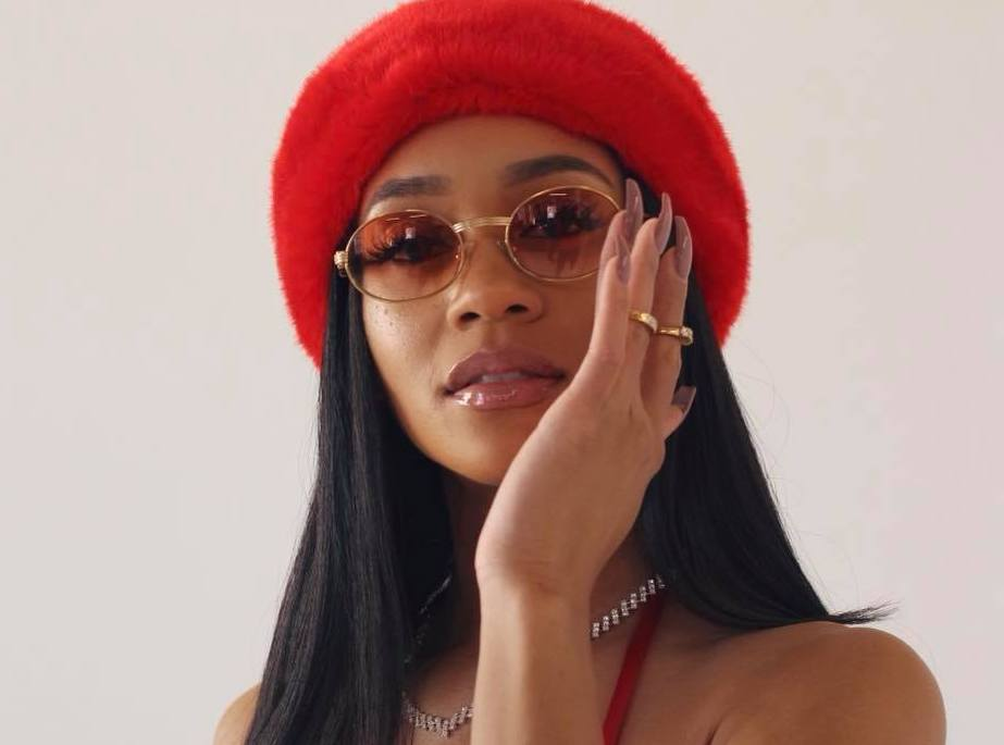 Saweetie press photo with red hat