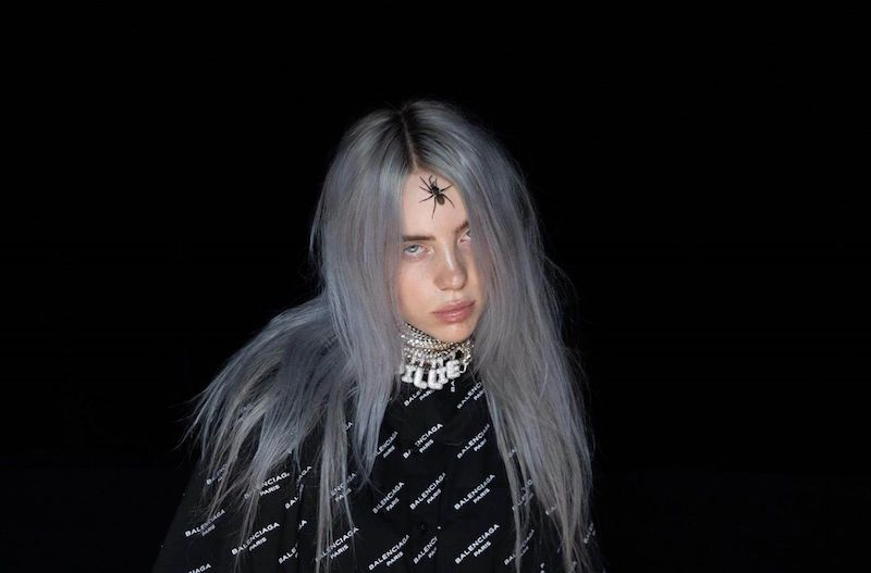 Billie Eilish press photo in the dark