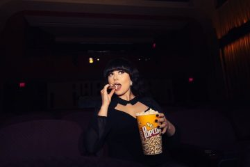 Ivory Layne eating popcorn at The Franklin Theatre