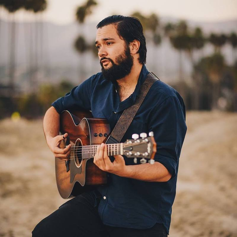 Will Breman press photo with guitar