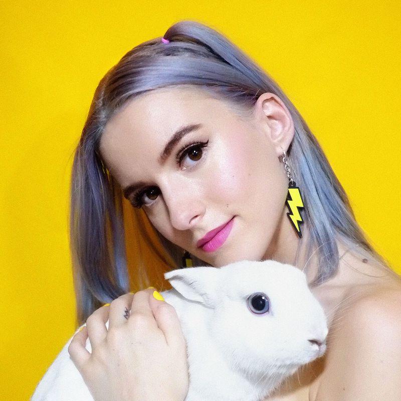 Virgin Miri press photo with a rabbit