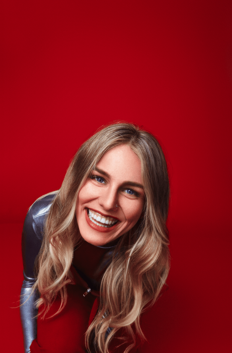 Lily Lewis press photo with red background