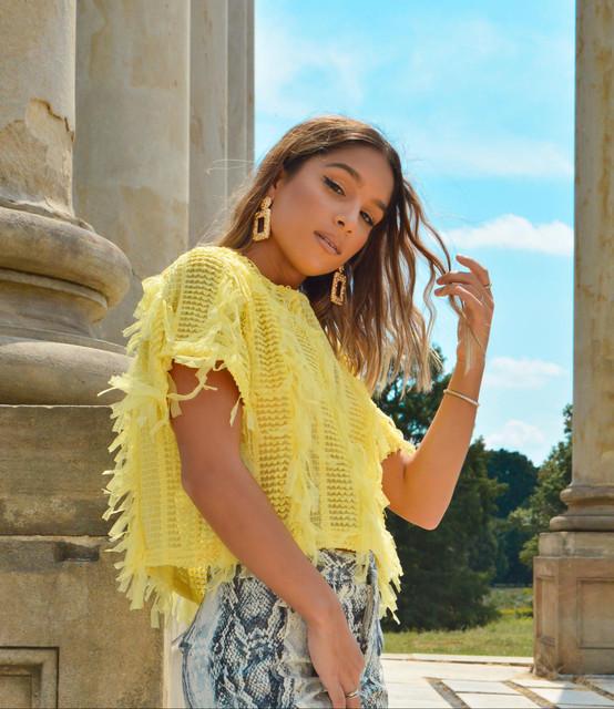 Thalia Falcon press photo yellow outfit