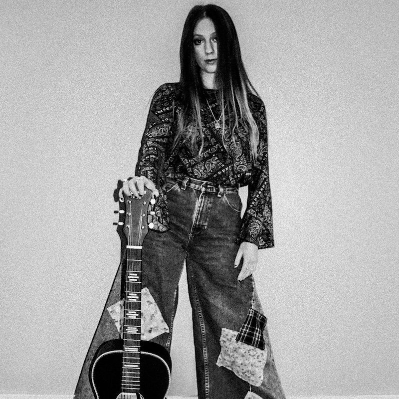 Gina Brooklyn press photo with guitar