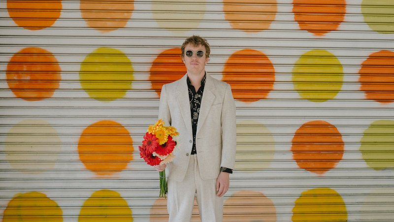 Evan Myall press photo with flowers
