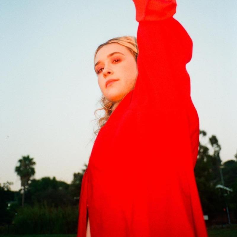 BAUM press photo in red outfit