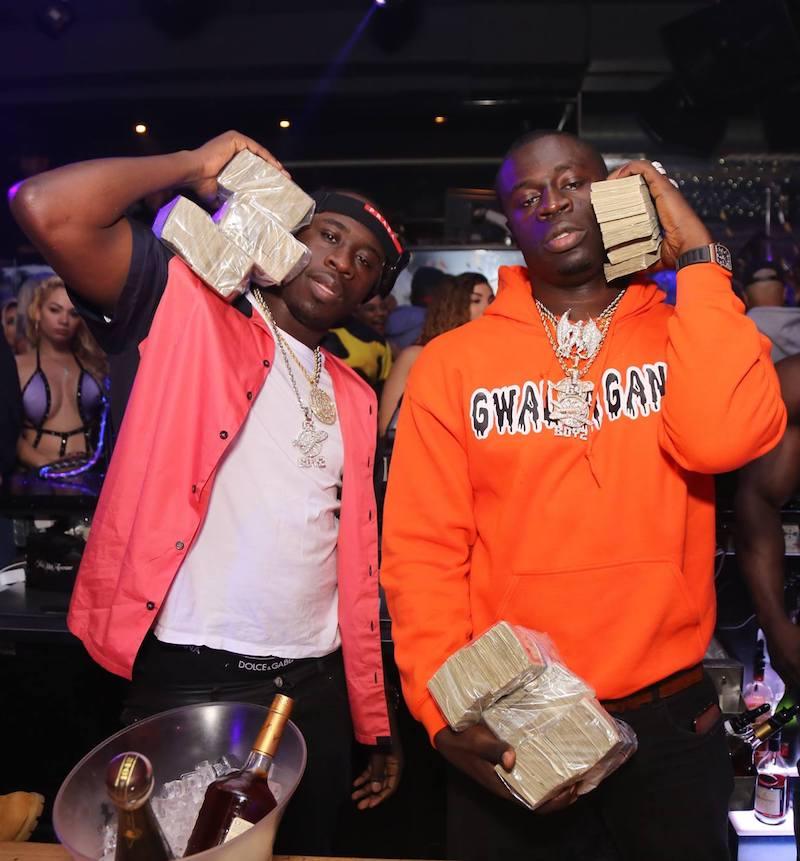 G4 BOYZ press photo wearing holding money