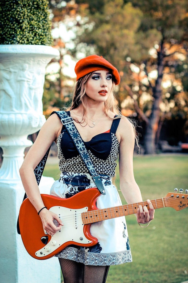 Madison Roe press photo with guitar