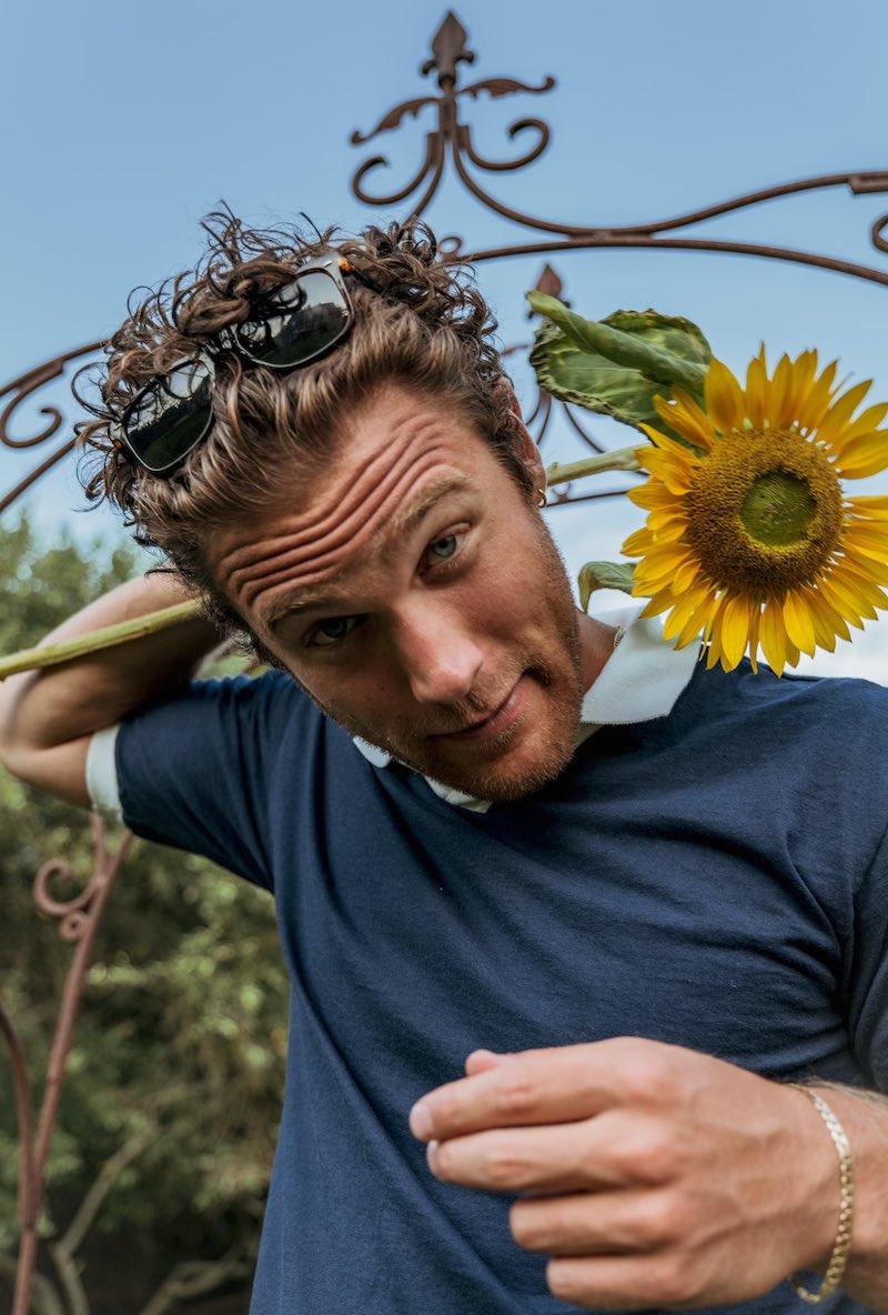Aaron Taos press photo with sunflower