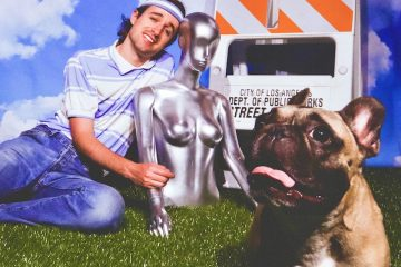 Louie Louie! press shot with dog and statue