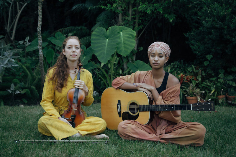 WILLOW & Jahnavi Harrison press photo with musical instruments - press photo by Rasa Partin