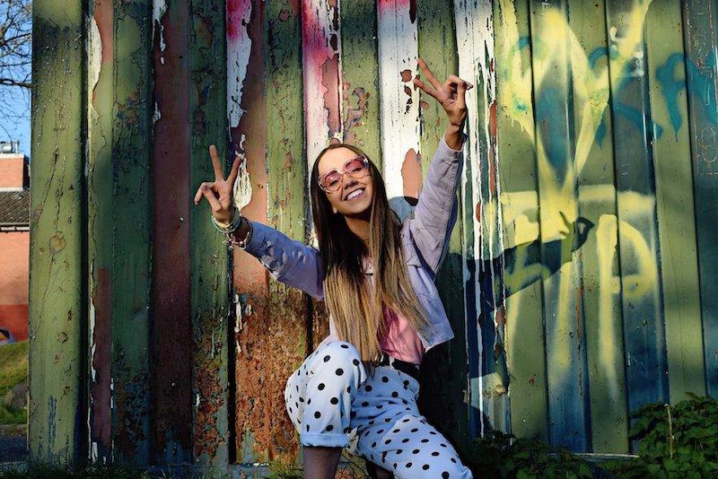 EMIAH press photo outside wearing polka dot pants.
