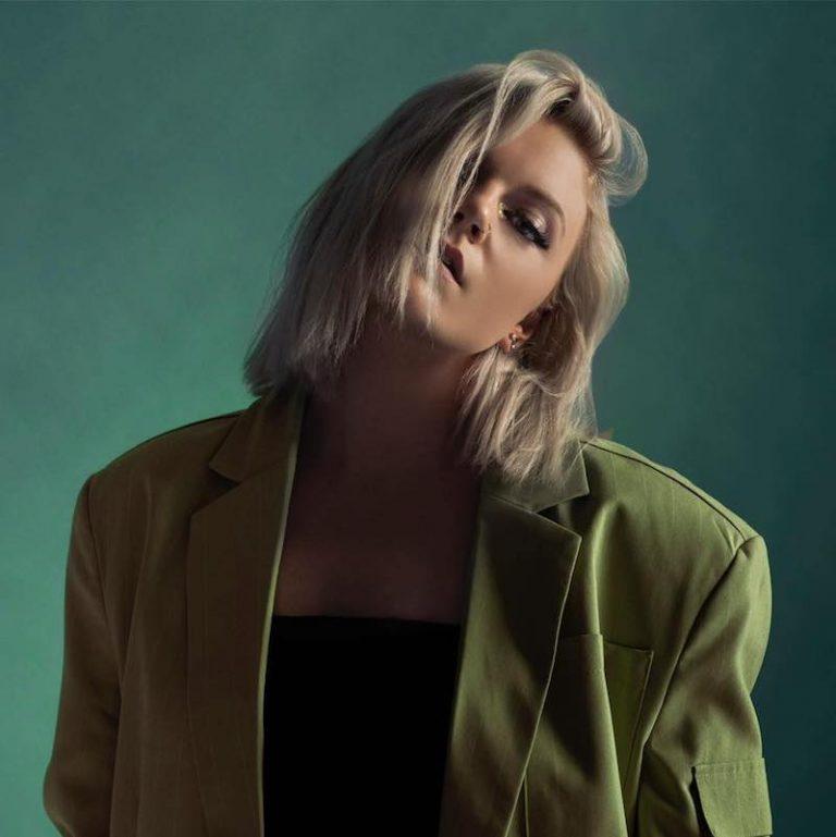 JESSIA press photo with a green background