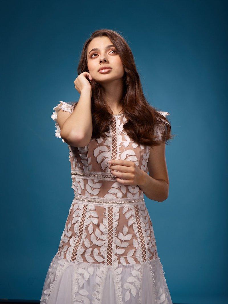 Laura Bretan press photo wearing an elegant white dress.