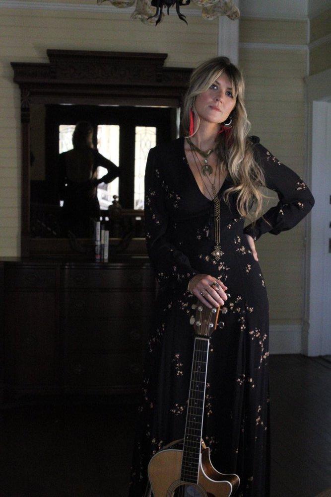 Lauren Spring press photo with guitar.