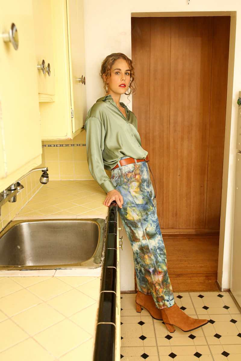 Michaela Slinger press photo standing in the kitchen.