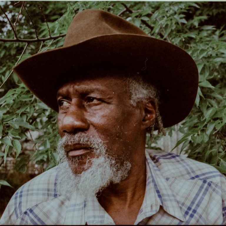 Robert Finley press photo outside in nature.