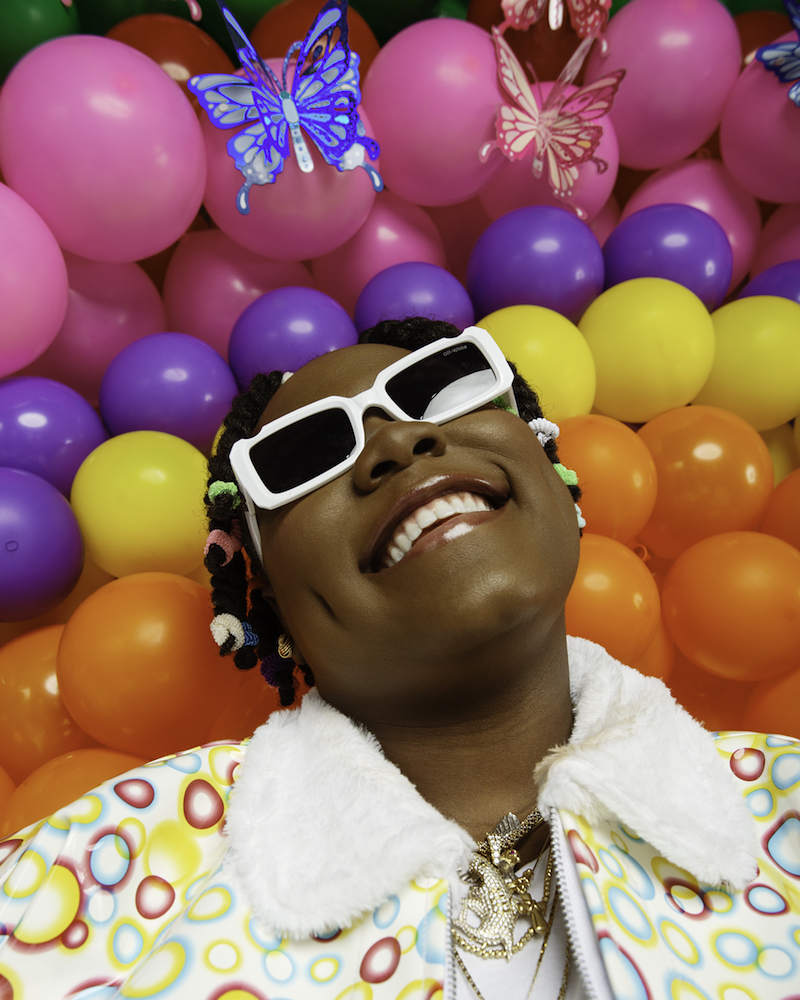Teni The Entertainer press photo smiling wholeheartedly like she just won a million dollars.