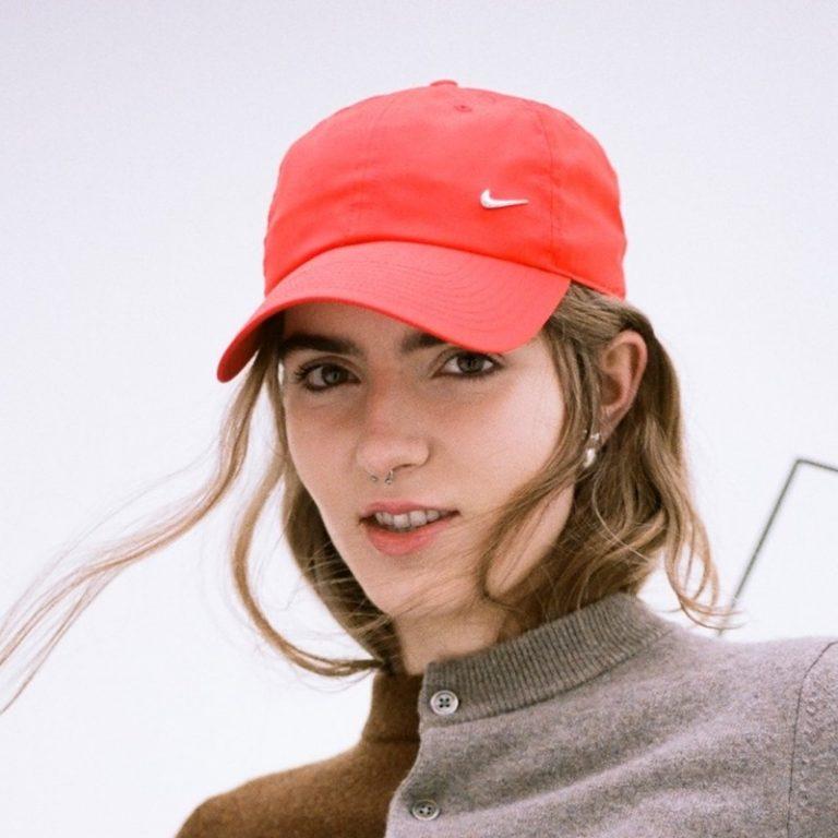 bülow press photo outside wearing a red hat.