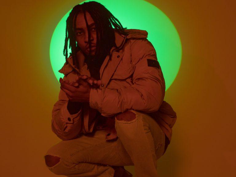 AcebergTM press photo wearing a coat