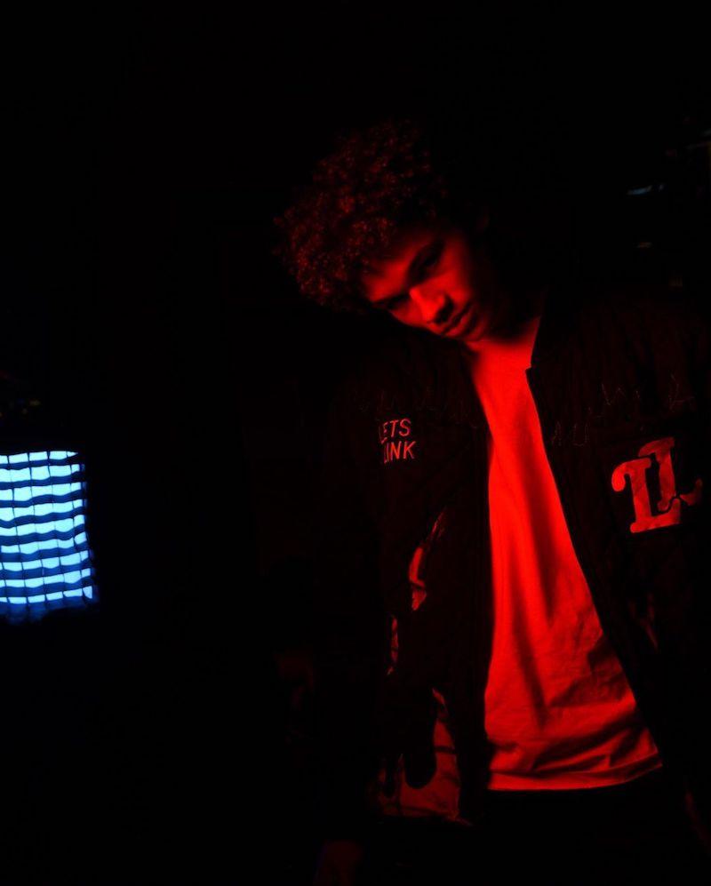 Armani Jackson press photo (black and red color theme)