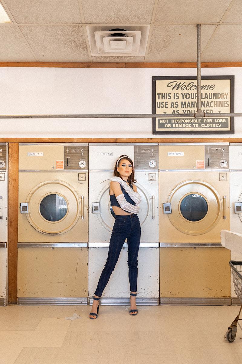 Gabriella Stella press photo inside a laundromat