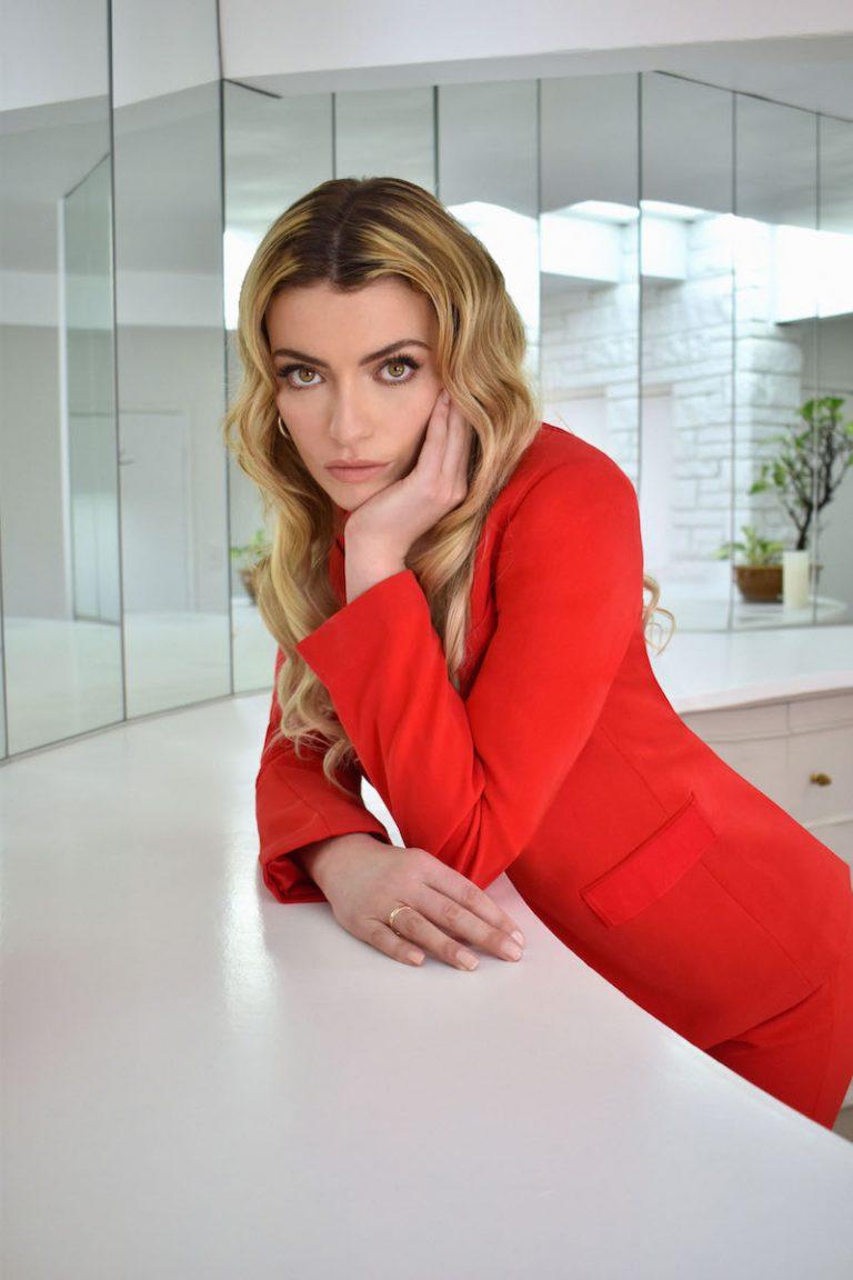 Lola Lennox WYG press photo wearing an elegant red outfit