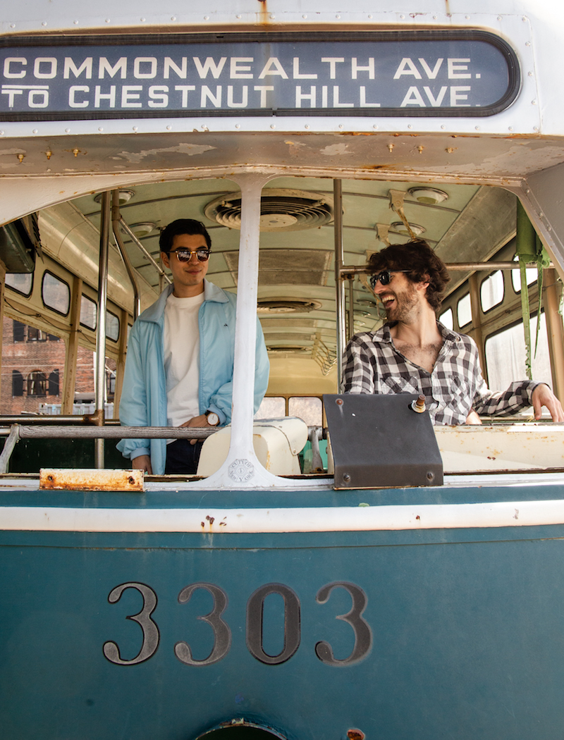 Max & Lamour press photo in Red Hook sitting inside an old-fashioned bus