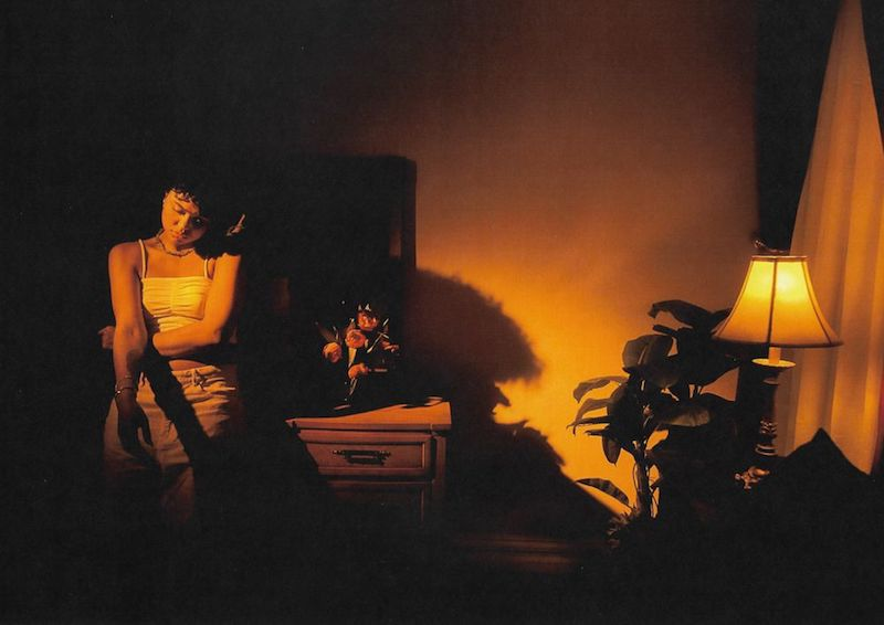 """Samaria - """"Out the Way"""" press photo inside a dim-lit bedroom"""