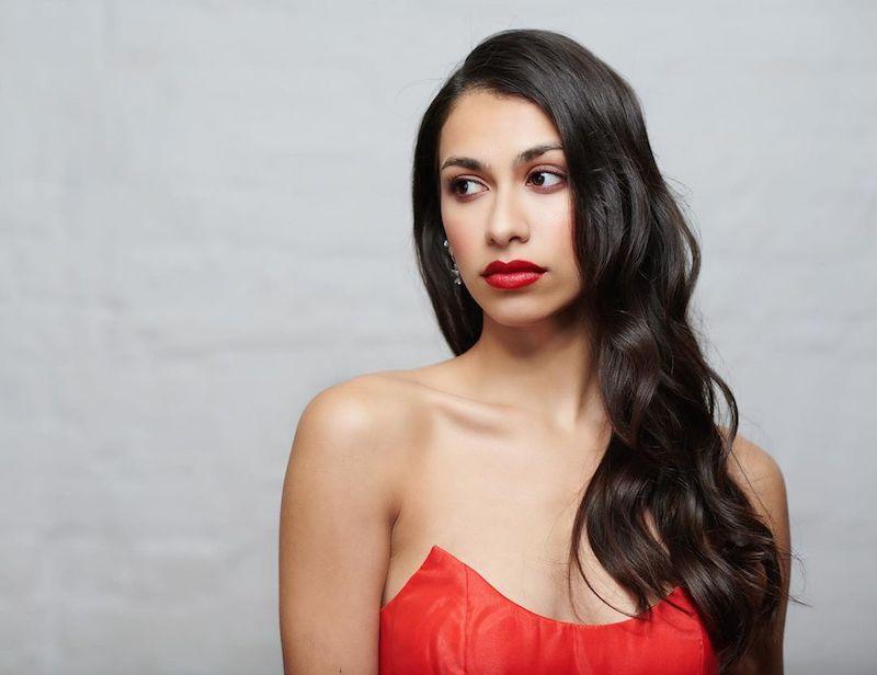 Sophie Naglik press photo wearing an elegant red dress