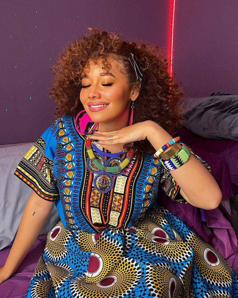 Talia Jackson press photo wearing a colorful African dress
