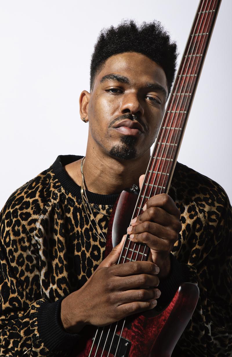 Trip Carter press photo with guitar