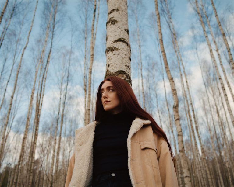 """Elina - """"Love Come Around"""" press photo outside in the woods"""