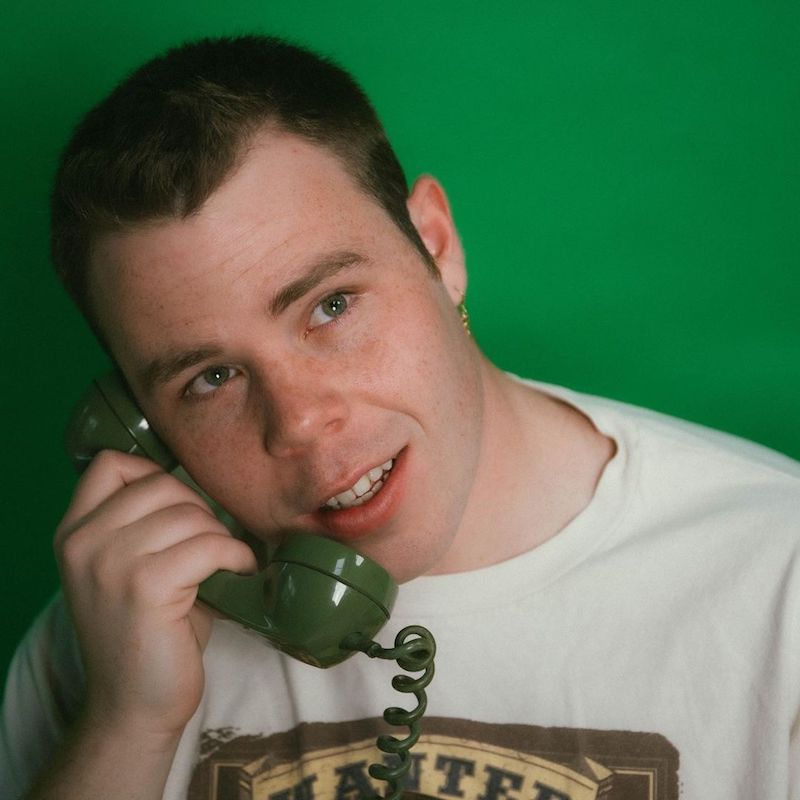 Inner State 81 press photo talking on the rotary phone
