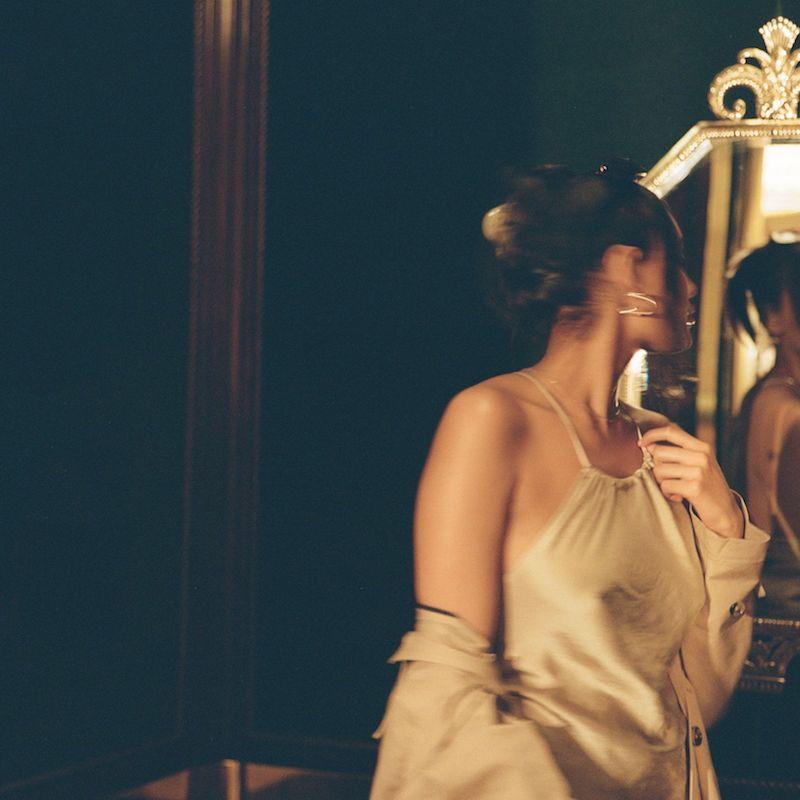 Liza press shot wearing a tanish-beige outfit