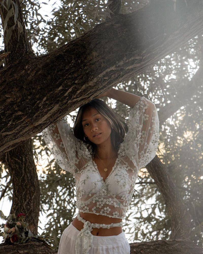 Louisa Laos press photo outside wearing an elegant outfit