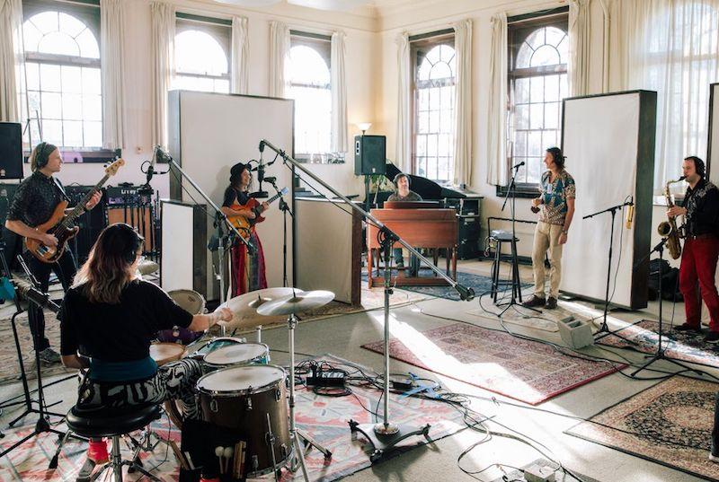 Rebecca Conner press photo in a spacious studio
