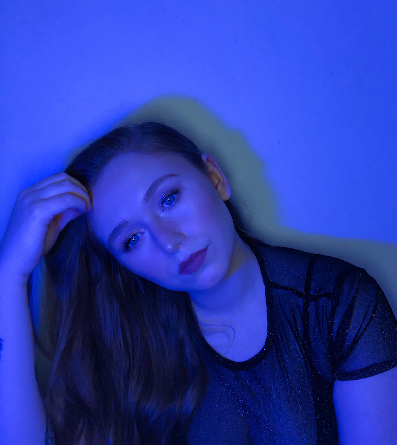 April Jai press photo with a blue background