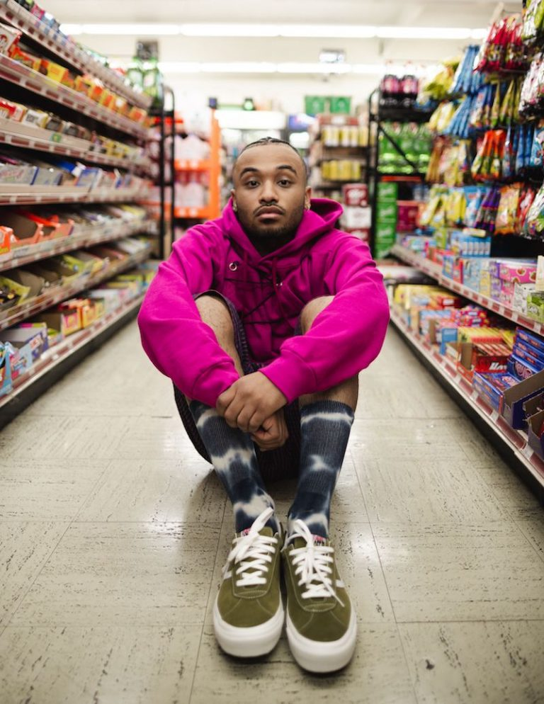 Daniyel press photo sitting in an aisle at a grocery store