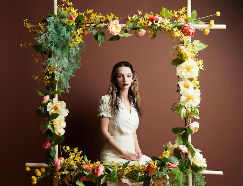 Gal Musette press photo with a flowered frame