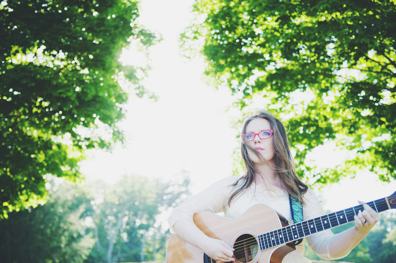 Grace Morrison press photo outside holding a guitar