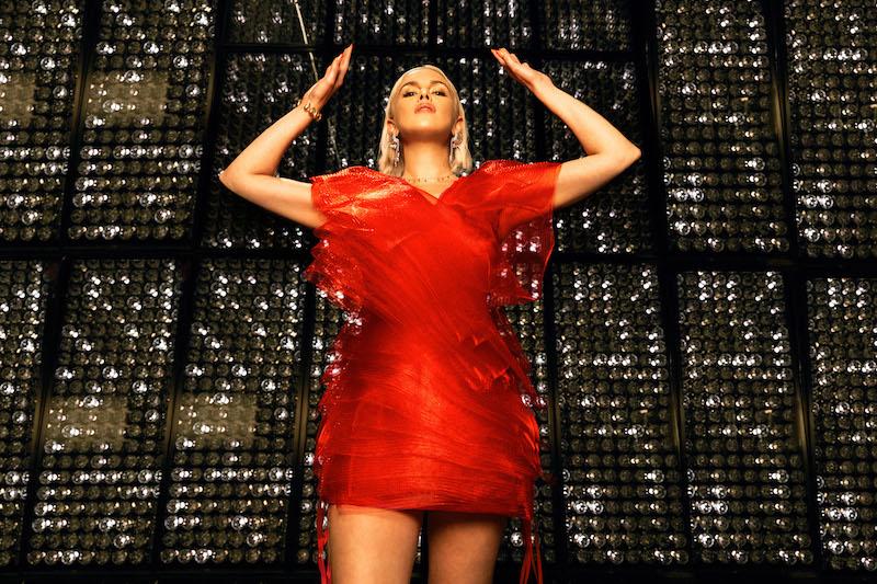 Grace Weber press photo wearing an elegant red dress