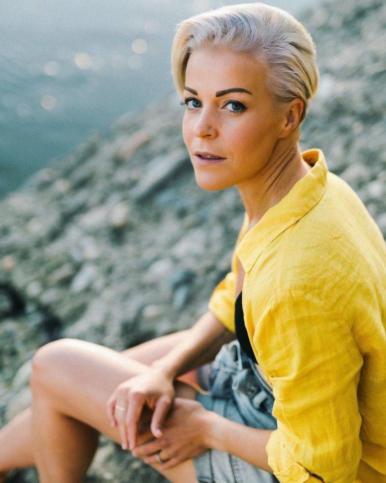 Kristina Nichol press photo wearing a yellow shirt