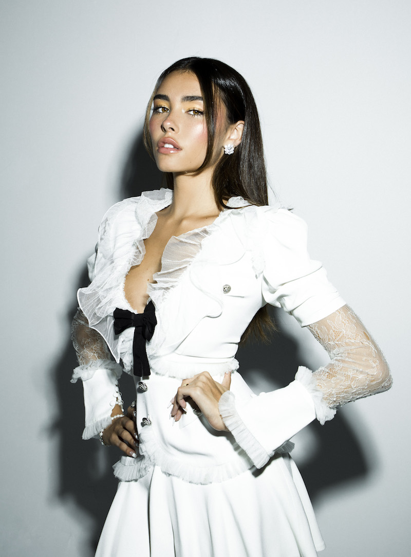 Madison Beer press photo wearing a fashionable white outfit