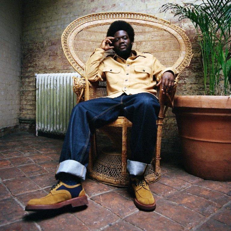 Michael Kiwanuka press photo sitting in a chair