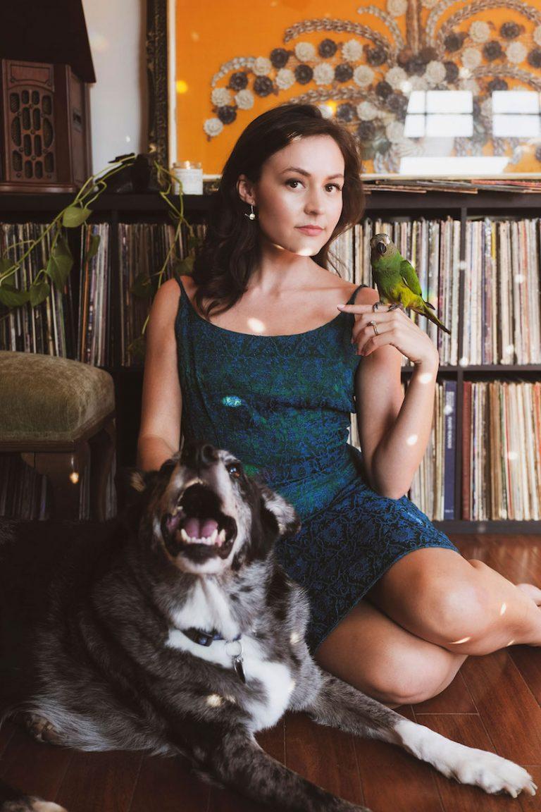 Monica Aben press photo with a dog and bird