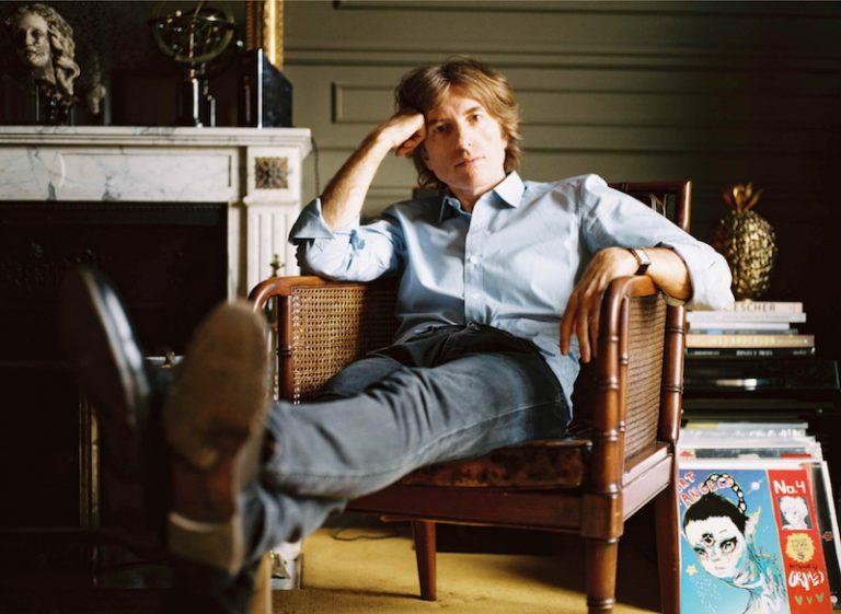 Nicolas Godin press photo sitting in a chair