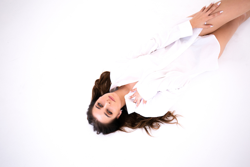 Tayler Jade press photo wearing a white outfit