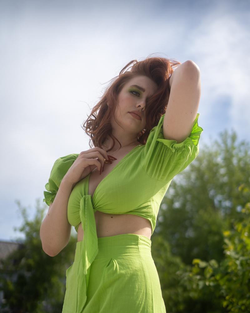 Tyra Jutai press photo wearing a lime green dress