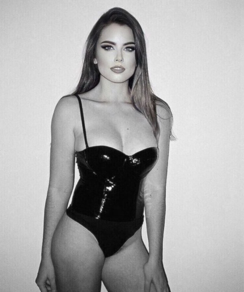 ZYRA press photo wearing a fitting black outfit